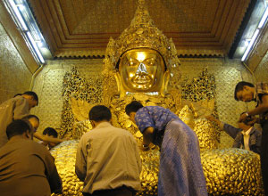 See the Seated Buddha at Mahamuni Pagoda