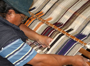 See traditional weaving skills in the Andean highlands
